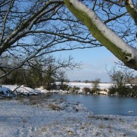 snowy pond and fields